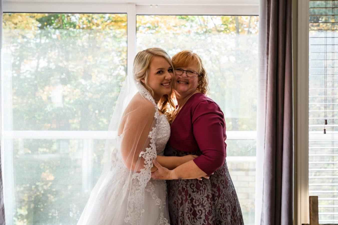 mom and bride getting ready, Ottawa wedding photographer