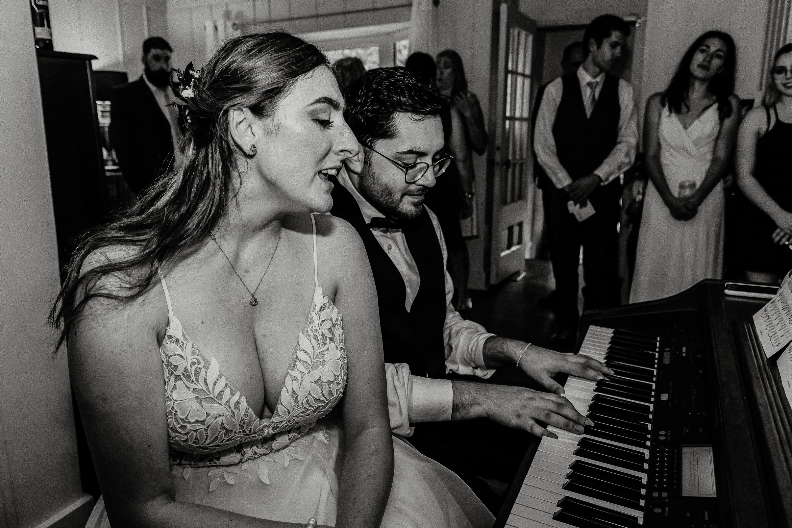 Heather Doughty Photography wedding couple singing at their elopement home wedding in Millbrook