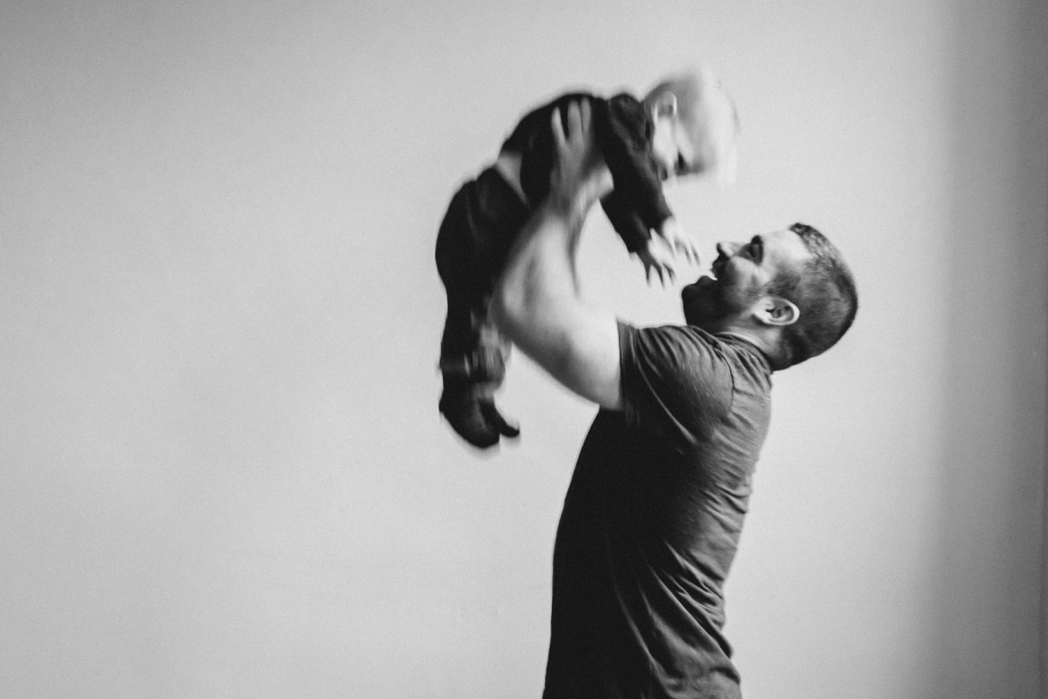dad and son playing during a lifestyle family photo session at downtown peterborough studio