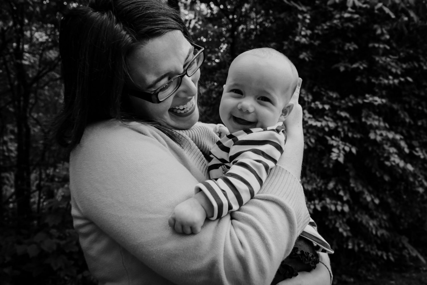 mom and baby laughing in fall at family photo session by cobourg family photographer, heather doughty photography
