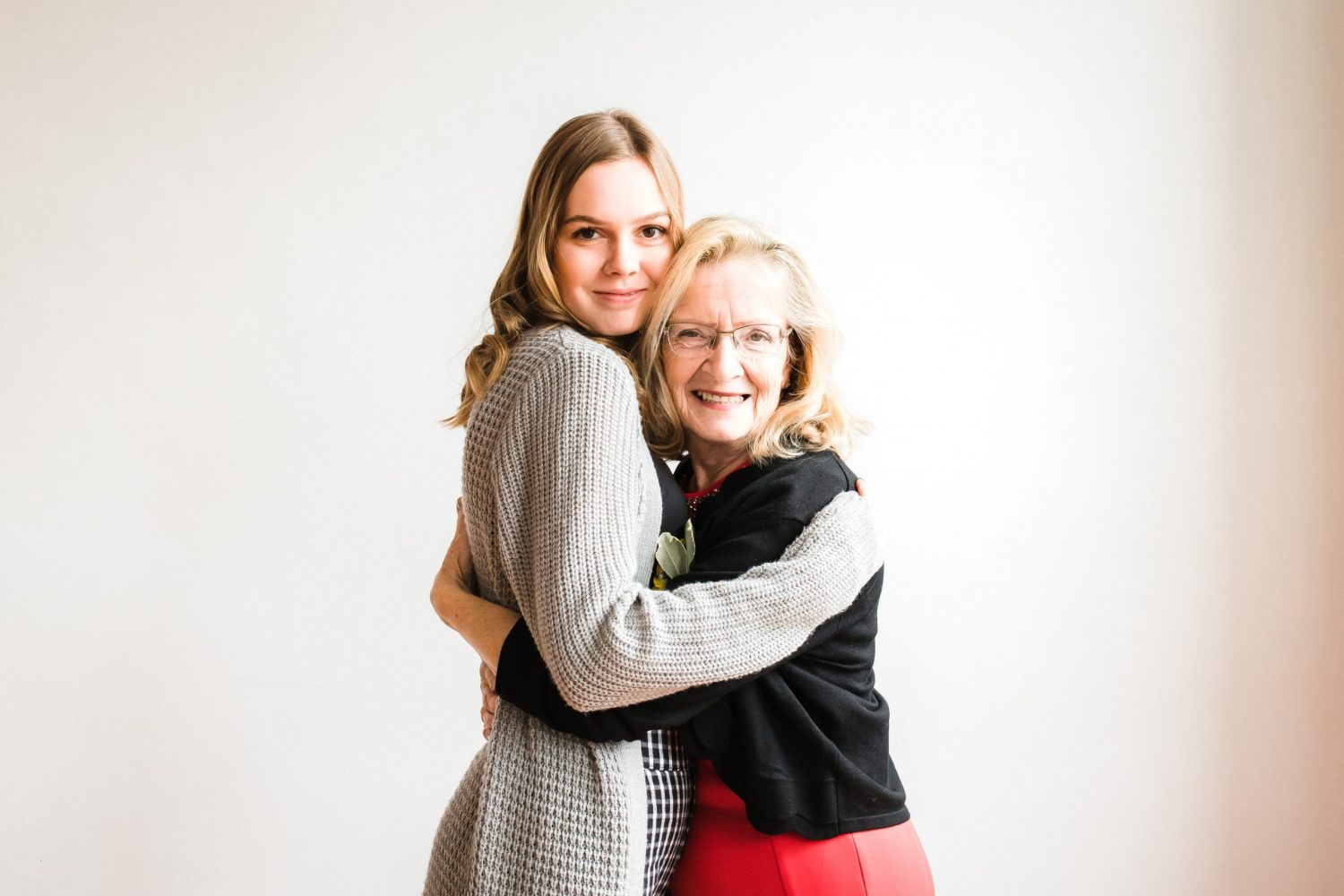 grandmother hugging granddaughter during lifestyle family photo session by ontario lifestyle photographer heather doughty photography at downtown peterborough studio