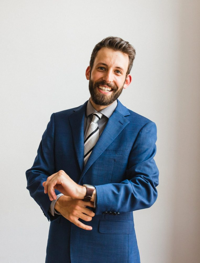 millenial corporate headshot with a guy in a blue suit for a lawyer by peterborough photographer heather doughty photography