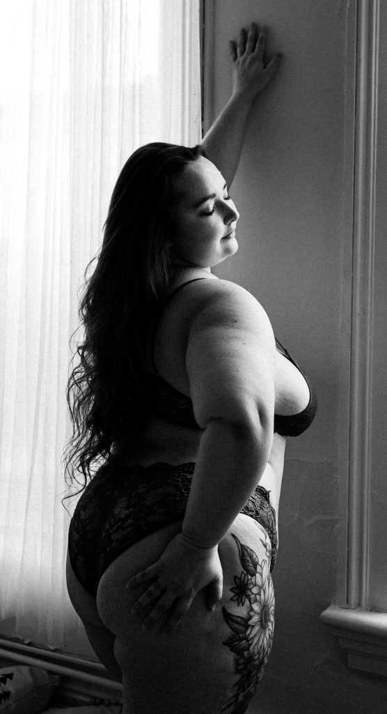 plus size woman in body positive boudoir session in heather doughty photography downtown peterborough studio